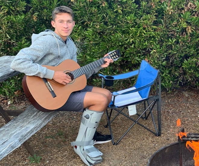 While recovering from stress factures in his legs, Newbury Park High cross country runner Davis Armstrong rediscovered his love for the guitar.