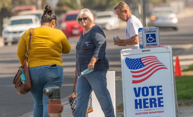 Voters cast ballots at the Manuel F. Hernandez Center in Visalia on Monday, November 2, 2020.