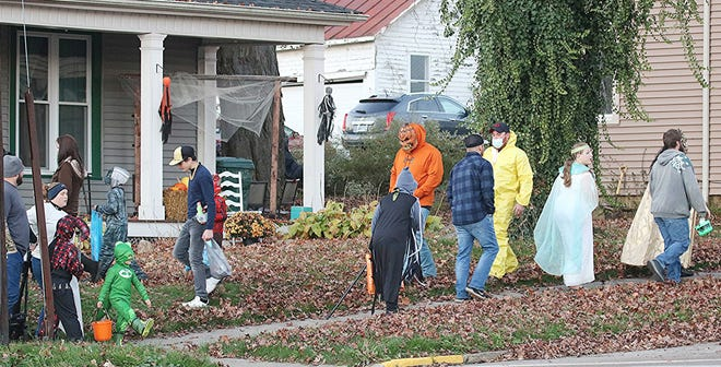 Trick-or-treaters take part in Jeromesville's trick or treat night Saturday, Oct. 31. Jeromesville Fire Department and EMS provided traffic control. It was originally scheduled for Thursday, but was postponed to Halloween due to rain.