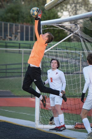 Pennsbury goalie Michael Caissie blocks a shot during a District One first-round playoff game on Monday, Nov, 2, 2020. The 15th-seeded Falcons shocked the No. 2 Panthers, winning 3-1 in penalty kicks in the 4A opener.