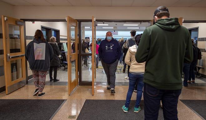 Residents wait their turn to vote  inside Bensalem High School, on Tuesday, Nov. 3, 2020.