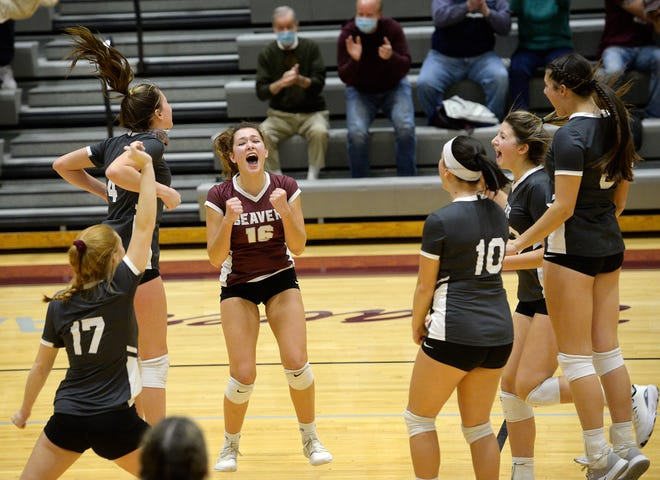 The Beaver Bobcats celebrate their 3-0 WPIAL Class 3A quarterfinal playoff match victory against Mars, Monday on their home court.