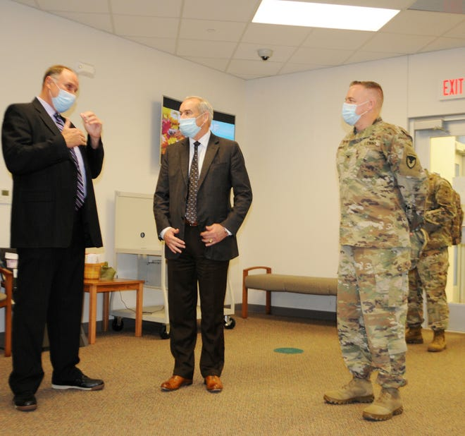 Honorable Dr. E. Casey Wardynski (center), assistant secretary of the Army for Manpower and Reserve Affairs, discusses education quality of life improvements with James Williams (left), Vernon Parish superintendent, and Col. Ryan K. Roseberry (right), Fort Polk garrison commander, Oct. 27, at Parkway Elementary School.