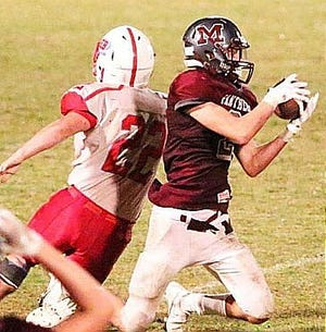 Merryville wide receiver Ross Cournoyer (2) hauls in one of his five receptions during the Panthers' win over Gueydan on Friday, 48-3. Cournoyer caught a career-high three touchdown passes in the contest.