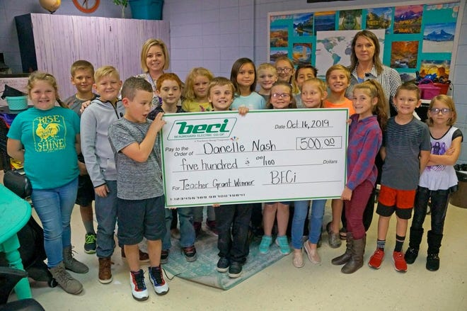 Danelle Nash, a fourth and fifth grade teacher at Evans High School, receives grant from BECi.