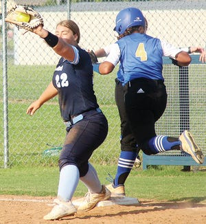 Bartlesville High first baseman Sydney Perry, left, snares the ball in time to make an out.