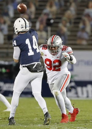 Ohio State defensive tackle Haskell Garrett pressures Penn State quarterback Sean Clifford. The Buckeyes hounded Clifford all game Saturday, sacking him five times.