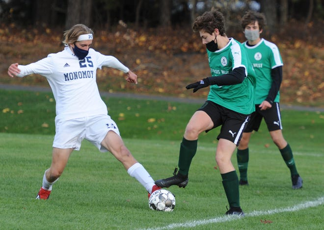 Monomoy's Connor Nicholson, left, and Sturgis West's Colin Sheehan look for a leg up in the first quarter of Monday's Cape & Islands Lighthouse division game in South Yarmouth.