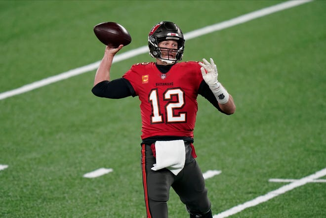 Tampa Bay Buccaneers quarterback Tom Brady looks to throw during the first half against the New York Giants on Monday night in East Rutherford, N.J.