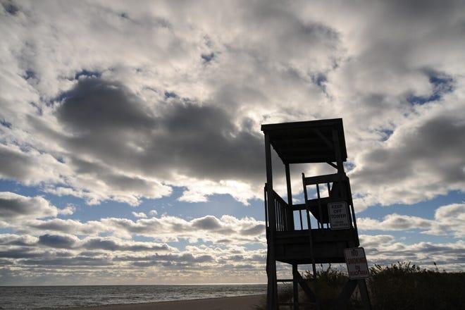 Dark skies over Bass River Beach start to break apart Monday afternoon.
