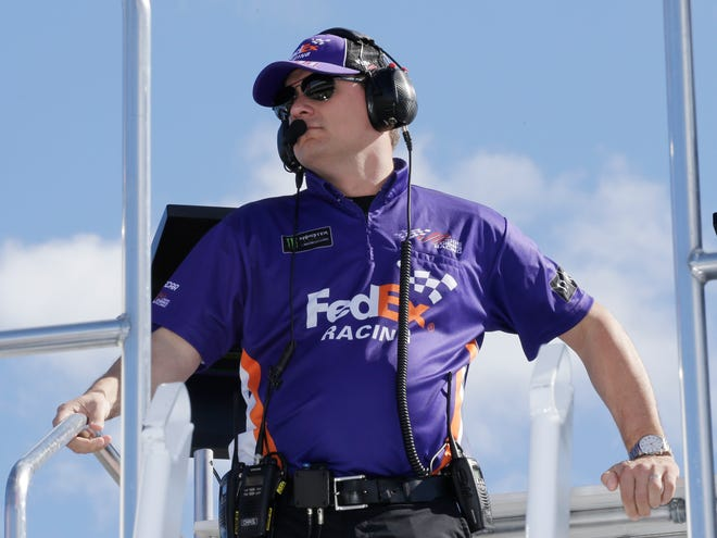 Crew chief Christopher Gabehart watches practice for a NASCAR Cup Series race at Homestead-Miami Speedway. The pressure will be intense for crew chiefs in NASCAR's championship race, so the team leaders must be on top of their game.