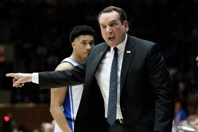 """""""We don't know a lot of things,"""" says Duke coach Mike Krzyzewski. """"But we know we're going to have March Madness. We know we're going to have a regular season."""" [Gerry Broome/AP File]"""