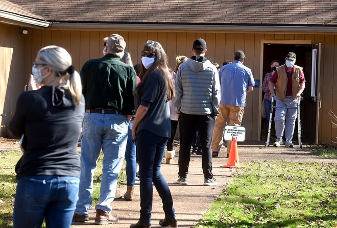 Voters wait in line Tuesday at the University of Missouri Extension center.