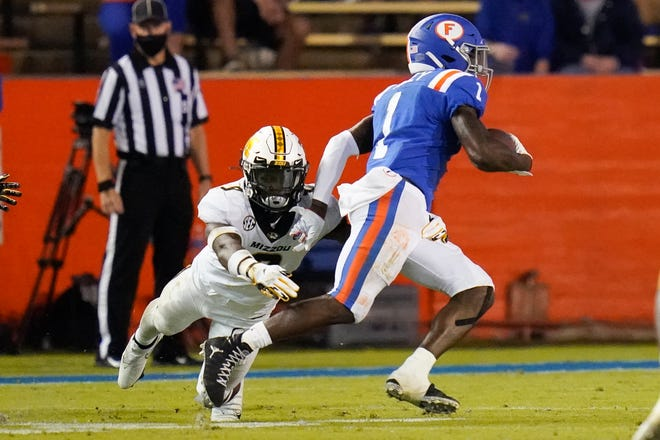 Florida wide receiver Kadarius Toney (1) breaks away from Missouri safety Tyree Gillespie, left, on his way to a touchdown during the first half of a game Saturday at Ben Hill Griffin Stadium in Gainesville, Fla.