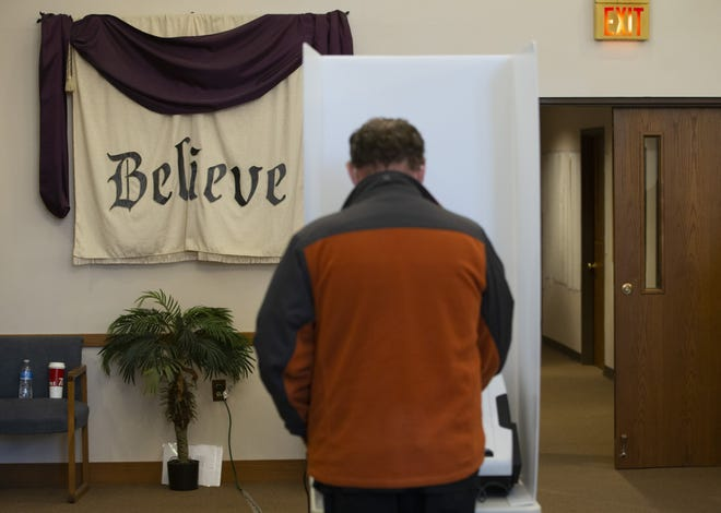Voters cast their ballots in Columbus at the Blendon Community Fellowship in Westerville on Tuesday, Nov. 3, 2020.