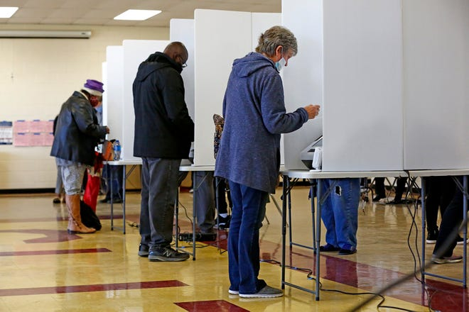 Voters showed up early at Linden Community Center in Columbus on Tuesday. A long line extended out the door as voting began at 6:30 a.m.