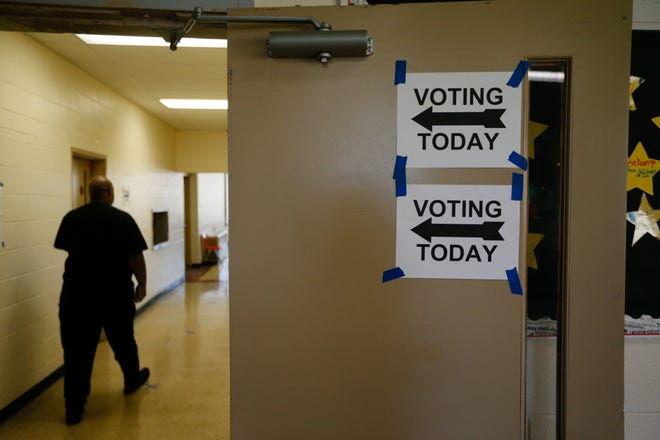 A voter walks in to cast their ballot during Election Day on Tuesday, Nov. 3, 2020 at the Linden Community Center in Columbus, Ohio.
