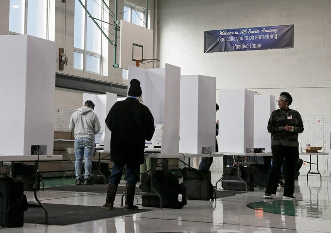 Voters cast their ballots in the gymnasium of All Saints Academy on Livingston Avenue on Columbus' East side on Election Day.
