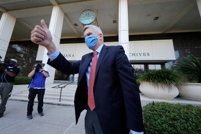 Sen. Bill Cassidy, R-La., acknowledges supporters as he arrives at the office of the Secretary of State in Baton Rouge to register as a candidate for re-election to the Senate July 24.