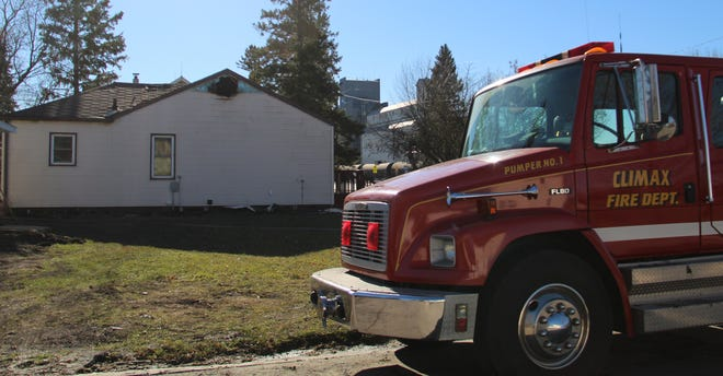 A Climax Fire Department truck remained parked at 110 Main Avenue North in Climax Tuesday afternoon after an early morning fire heavily damaged the house.
