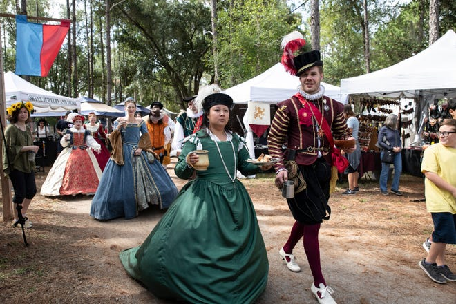 The royal party makes their way through the marketplace at the Lady of the Lakes Renaissance Faire in 2019. This year's version will be held virtually.