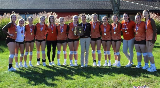 Meadowbrook High's volleyball team pose with their Division II District Championship hardware following Saturday's win over John Glenn. The Lady Colts improved to 22-2 on the season and will now meet Sheridan on Thursday, 5:30 p.m. at Pickerington North in Division II Regional semi-final action.