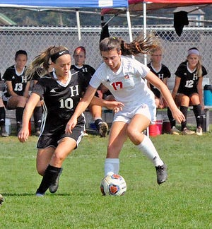 Hiland's Gabby Schlabach (left) has been one of Hiland's best girls soccer players in program history, scoring a school-record 37 career goals.
