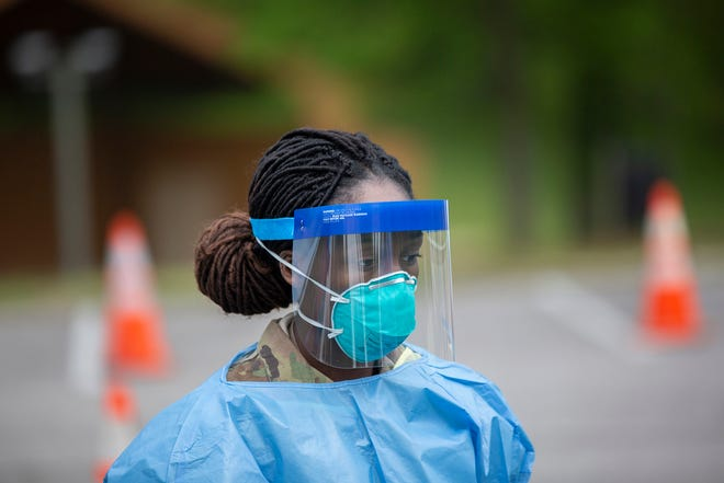 National Guard member Tiffanie Garrison-Jeter prepares to assist members of the public during the first day of mass testing for the COVID-19 virus in Maury County on Saturday, April 18, 2020.