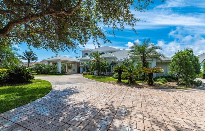 This outstanding custom estate is situated on 2.3 private acres, with a remarkable 153 linear feet of Intracoastal Waterway frontage – all within the gates of coveted Island Estates.