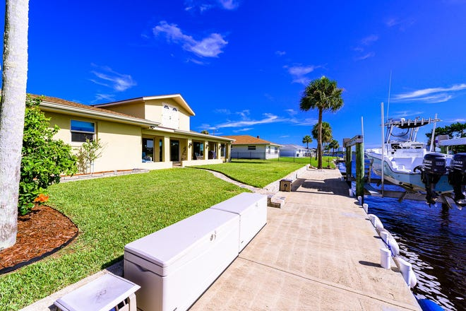 This gorgeous river-view home is located directly on a deep-water canal, just two homes from the Intracoastal Waterway and includes a 16,000-pound boat lift.