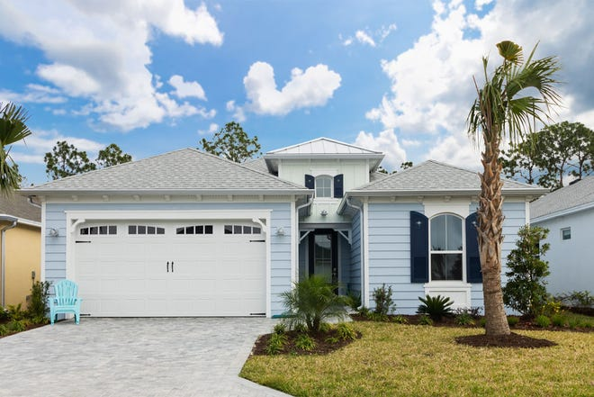 A pavered drive and walkway lead into this move-in-ready Coconut model, located in the maintenance-free, luxury resort-style 55-and-over community of Latitude Margaritaville.