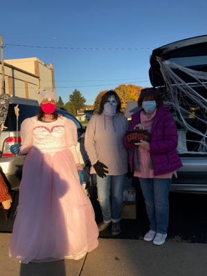 Wayland American Legion Ladies' Auxiliary members Elizabeth Holubek, Kelly Harrison and Judy Perkowski handed out candy and coloring books.
