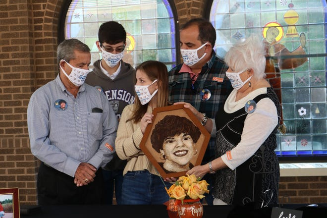 The Guillot family, including Don, Peggy, Shane, Wyatt, and Shawn, unveiled a floragraph featuring the late Shawn Guillot. The floragraph will be on display as a part of the Tournament of Roses Parade.