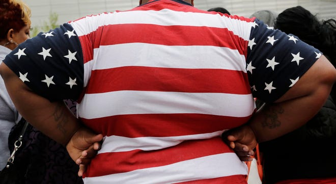 An overweight person is seen in New York in 2014. As obesity rates climb in the U.S., more Americans say they're following special diets compared with a decade ago.