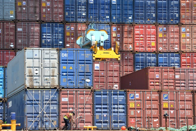 The global COVID-19 pandemic caused a 5 percent drop in cargo containers handled by JaxPort tenants during the 2020 fiscal year. In this file photo, the metal boxes are moved at the Blount Island Marine Terminal.