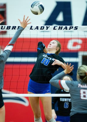 Gunter's Hanna Rubis attacks at the net in the Lady Tigers' area round victory against Ponder at Aubrey.