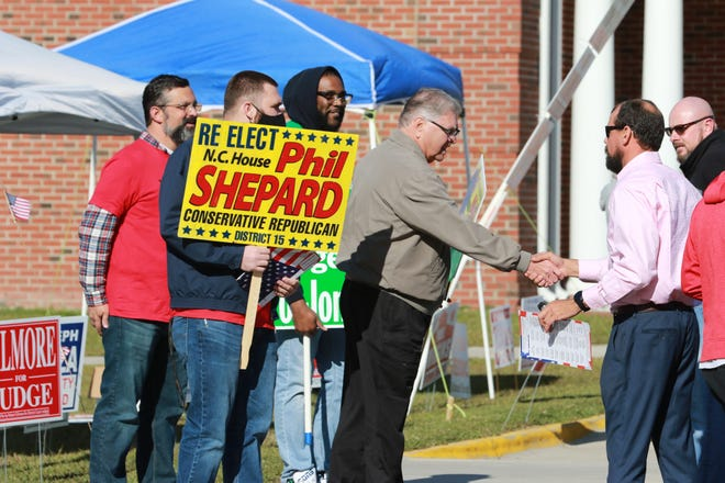 Phil Shepard speaks with a voter at Catalyst Church in Jacksonville as folks turned out to vote Tuesday, 3 November 2020.  [John Althouse / The Daily News]