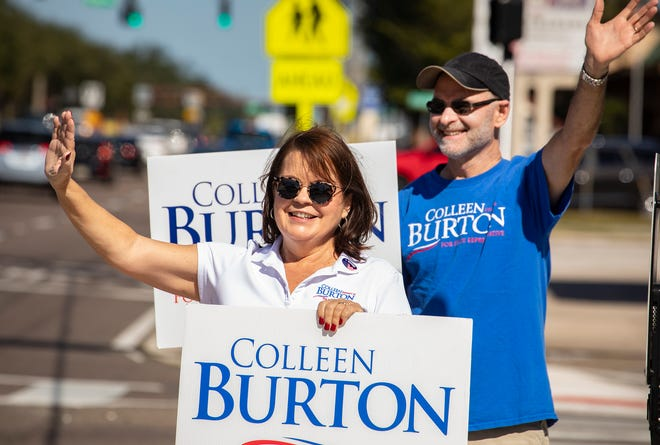 State Rep. Colleen Burton, R-Lakeland, campaigns with her husband Brad on Election Day on the corner of South Florida Avenue and Edgewood Drive in Lakeland.