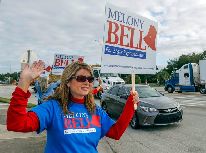 State Rep. Melony Bell, R-Fort Meade, campaigns outside city hall in Fort Meade on Tuesday.