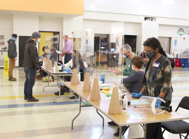 Voters registering before voting at Pell Elementary School on Tuesday morning.