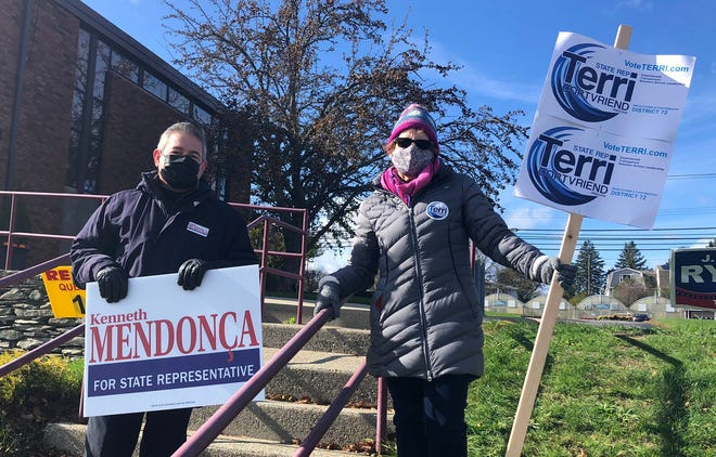 House District 72 opponents Terry Cortvriend, the incumbent, and Kenneth Mendonca chatted in the morning at the polling location at St. Barnabas in Portsmouth.