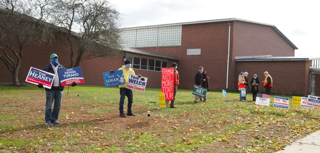 Supporters holding signs outside Middletown High School polling place on Tuesday morning.