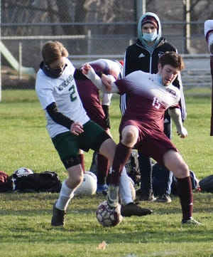 Westmoreland-Oriskany senior Trevor Tamburino and Clinton senior Daniel Frank battle for position as they go for the ball during the first half of a Center State Conference match Tuesday afternoon on the Clinton Central School grounds. Clinton scored four goals in about the first 15 minutes of the game to build help a halftime lead and earned a 5-1 win.