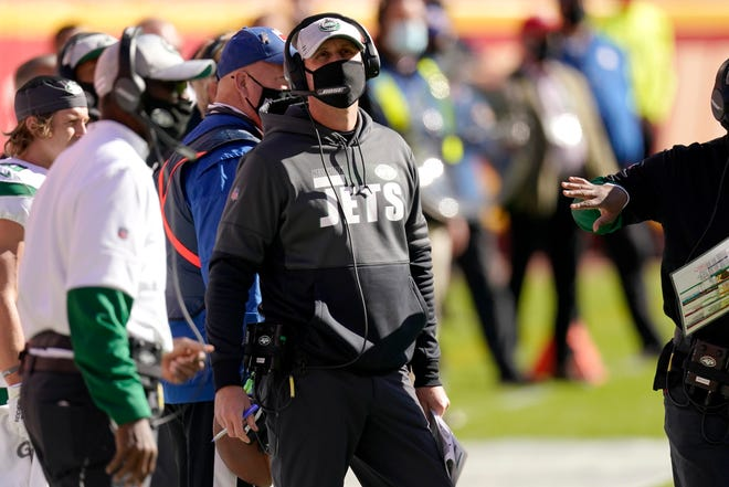 New York Jets head coach Adam Gase watches play against the Kansas City Chiefs in the first half of an NFL football game on Sunday in Kansas City, Mo.