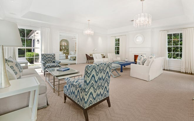 The expansive living room at 310 Plantation Road has an 11-foot tray ceiling among its features. The updated house on Palm Beach's North End is listed for sale at $5.8 million.