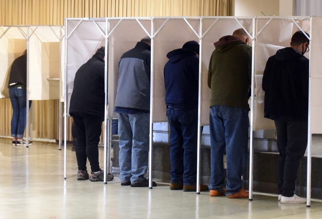 Voters casting ballots at a Seacoast community during the Nov. 3 general election.