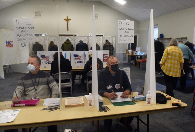 Clerks at Dover's Ward 3 wait for voters to check in to cast their ballots at Parish of the Assumption-St. Joseph's Tuesday, Nov. 3, 2020.