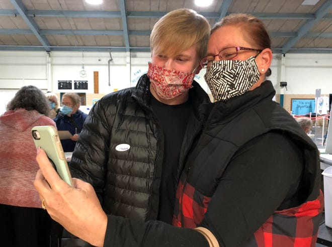 Tracy Craig and her 19-year-old son Kealian, seen Tuesday, Nov. 3, 2020 at the Rochester Ward 2 polls, don't agree on President Donald Trump and Joe Biden, but it hasn't affected their relationship.