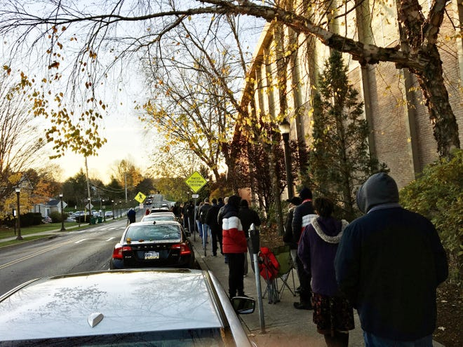 Early morning sunlight shines in East Stroudsburg as voters line up at the Koehler Field House polling place at East Stroudsburg University on Election Day.