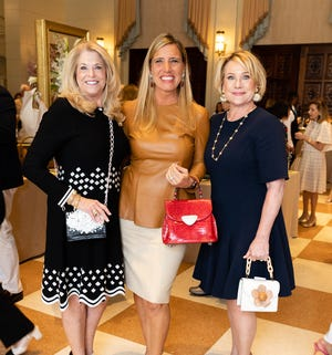Board members attend a recent Old Bag Luncheon that benefits the Center for Family Services. From left, Karen Swanson, board chairwoman, Daniella Ortiz, Old Bags Luncheon 2021 chairwoman, and  Tammy Pompea, board vice chairwoman.